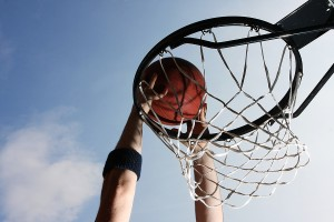 Close-up of basketball player dunking a ball